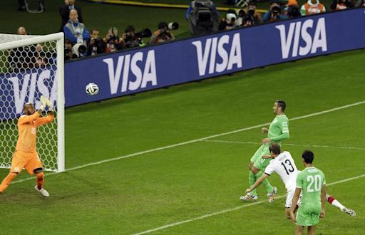 ADVANCE FOR WEEKEND EDITIONS, JULY 4-6 - FILE - In this June 30, 2014 file photo, an advertisement for official FIFA sponsor Visa is shown, at rear, as Algeria's goalkeeper Rais M'Bolhi, left, deflects a header by Germany's Thomas Mueller during a World Cup round of 16 soccer match in Porto Alegre, Brazil, Monday, June 30, 2014. FIFA vowed to crack down on non-sponsors this year, going so far as to tape over the band name of the hand dryers in stadium restrooms. Sponsors are the second-biggest source of revenue for the organization, behind broadcast rights. (AP Photo/Thanassis Stavrakis, File)