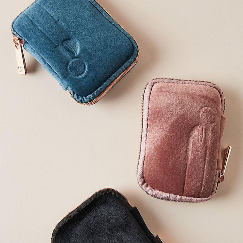 """<p><strong>MYTAGALONGS Anthropologie</strong></p><p>anthropologie.com</p><p><strong>$10.00</strong></p><p><a href=""""https://go.redirectingat.com?id=74968X1596630&url=https%3A%2F%2Fwww.anthropologie.com%2Fshop%2Fvixen-earbud-case2&sref=https%3A%2F%2Fwww.prevention.com%2Flife%2Fg30025627%2Fcheap-stocking-stuffers%2F"""" rel=""""nofollow noopener"""" target=""""_blank"""" data-ylk=""""slk:Shop Now"""" class=""""link rapid-noclick-resp"""">Shop Now</a></p><p>Finally! A tech case that's super cute and functional. Perfect for your friend who needs help in the organization department, this suede-looking pouch will keep earbuds and charging cords all in one place. And with three fun color options to choose from, this will be easy to find in their <a href=""""https://www.amazon.com/Vera-Bradley-Signature-Cotton-Cloud/dp/B07YD4Q6LC?tag=syn-yahoo-20&ascsubtag=%5Bartid%7C2141.g.30025627%5Bsrc%7Cyahoo-us"""" rel=""""nofollow noopener"""" target=""""_blank"""" data-ylk=""""slk:tote"""" class=""""link rapid-noclick-resp"""">tote</a>. </p>"""