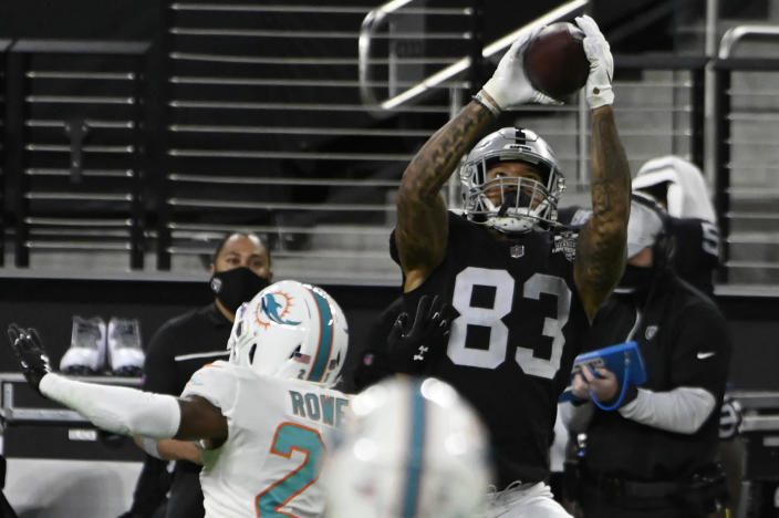 Las Vegas Raiders tight end Darren Waller (83) makes a reception against the Miami Dolphins during the first half of an NFL football game, Saturday, Dec. 26, 2020, in Las Vegas. (AP Photo/David Becker)