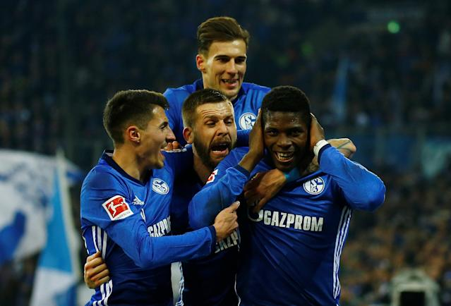 Soccer Football - Bundesliga - Schalke 04 vs TSG 1899 Hoffenheim - Veltins-Arena, Gelsenkirchen, Germany - February 17, 2018 Schalke's Breel Embolo celebrates with team mates after scoring but his goal is subsequently disallowed after consultation with the video assistant referee REUTERS/Leon Kuegeler DFL RULES TO LIMIT THE ONLINE USAGE DURING MATCH TIME TO 15 PICTURES PER GAME. IMAGE SEQUENCES TO SIMULATE VIDEO IS NOT ALLOWED AT ANY TIME. FOR FURTHER QUERIES PLEASE CONTACT DFL DIRECTLY AT + 49 69 650050