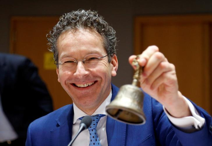 Eurogroup President Dijsselbloem rings the bell at the start of a eurozone finance ministers meeting in Brussels