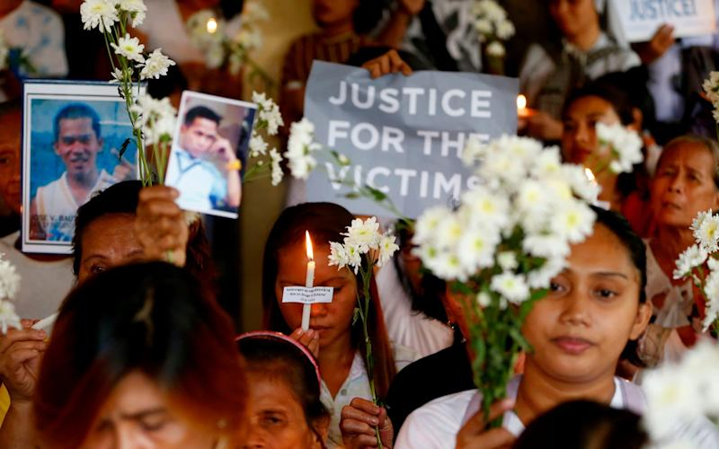 Relatives of victims of the Philippines war on drugs hold a memorial for their loved ones - AP