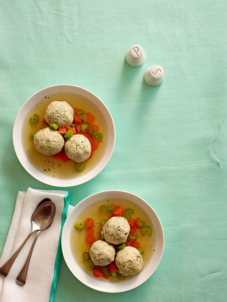"<p>Matzo ball soup is one of the most classic Passover recipes available. To turn this tried-and-true meal into a vegetarian option, substitute vegetable broth for chicken broth. It's really that easy! </p><p><strong><em><a href=""https://www.womansday.com/food-recipes/food-drinks/recipes/a12334/matzo-balls-recipe-wdy0414/"" rel=""nofollow noopener"" target=""_blank"" data-ylk=""slk:Get the Matzo Ball Soup recipe."" class=""link rapid-noclick-resp"">Get the Matzo Ball Soup recipe. </a></em></strong></p><p><strong><a class=""link rapid-noclick-resp"" href=""https://www.amazon.com/Manischewitz-Matzo-Passover-Canis-Total/dp/B07B4GQ4B3/ref=sr_1_1?dchild=1&keywords=MATZO+MEAL&qid=1610039061&sr=8-1&tag=syn-yahoo-20&ascsubtag=%5Bartid%7C10070.g.35142478%5Bsrc%7Cyahoo-us"" rel=""nofollow noopener"" target=""_blank"" data-ylk=""slk:SHOP MATZO MEAL"">SHOP MATZO MEAL</a></strong></p>"
