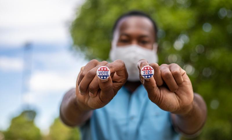 You can clear some of the hurdles preventing your family and friends from voting by helping them register on time, apply for a mail-in ballot, find their polling place or get to the polls. (Photo: LPETTET via Getty Images)
