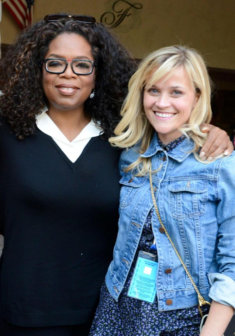 Oprah Winfrey has admitted that in the wake of the Harvey Weinstein scandal she feels Reese Witherspoon suffered from post-traumatic stress disorder. The pair are pictured here in 2014. Source: Getty