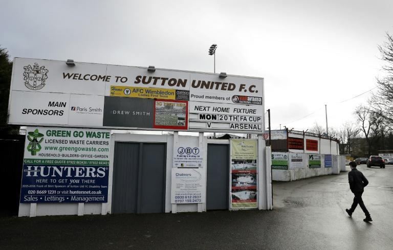 A fan walks past the main turnstile at Sutton United's stadium ahead of their FA Cup fifth round match against Arsenal on February 20, 2017