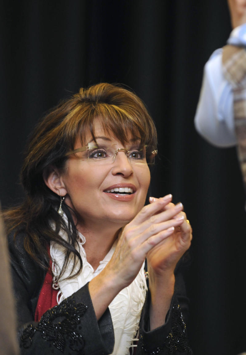FILE - In this Dec. 3, 2010, file photo former Alaska Gov. Sarah Palin talks during a book signing in Columbia, S.C.  By this point every four years, South Carolina expects to see a flood of White House hopefuls crossing the state. This time the tea party has upended the political landscape as Republicans weighing presidential bids have all but ignored the state that in modern history has played an outsized role in GOP nomination fights. (AP Photo/Virginia Postic, File)