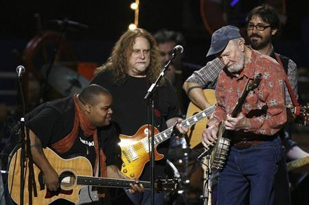 Musician Seeger performs with Reagan and Haynes during a concert celebrating Seeger's 90th birthday in New York