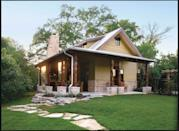 """<p>This 500-square-foot cabin lives large thanks to its alfresco living area. With its covetable outdoor fireplace, the covered porch is just as livable in the winter as it is the summer. Inside, find an open concept kitchen and living area, plus one bedroom and one bath.</p> <p>1 bedroom, 1 bath</p> <p>500 square feet</p> <p>See plan: <a href=""""https://houseplans.southernliving.com/plans/SL1450?index=1&search%5Bplan%5D=guest+&search%5Butf8%5D=✓&search%5Bvendor%5D="""" rel=""""nofollow noopener"""" target=""""_blank"""" data-ylk=""""slk:Cedar Creek Guest House (SL-1450)"""" class=""""link rapid-noclick-resp"""">Cedar Creek Guest House (SL-1450)</a></p>"""
