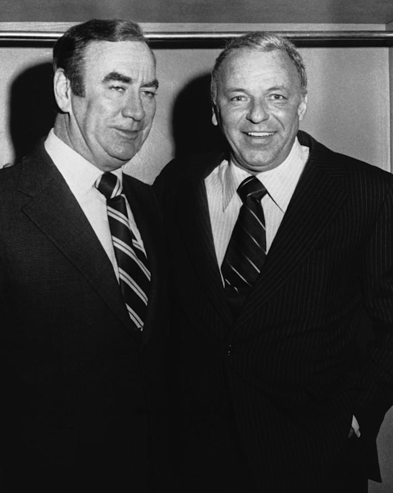 FILE - In this September 1975 file photo, New York Gov. Hugh Carey, left, visits singer Frank Sinatra backstage at the Uris Theater in New York, after Sinatra's performance. Carey, who led the rescue effort that brought New York City back from the brink of bankruptcy during its 1975 fiscal crisis, died Sunday, Aug. 7, 2011. He was 92. (AP Photo, File)