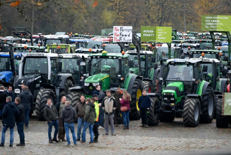 Farmers protest with their tractors against the government's environmental policies including plans to phase out glyphosate pesticides in Dortmund, western Germany on November 25, 2019. - Farmers from all over the country are on their way to Berlin where they will stage further protest on November 26, 2019. (Photo by INA FASSBENDER / AFP) (Photo by INA FASSBENDER/AFP via Getty Images)