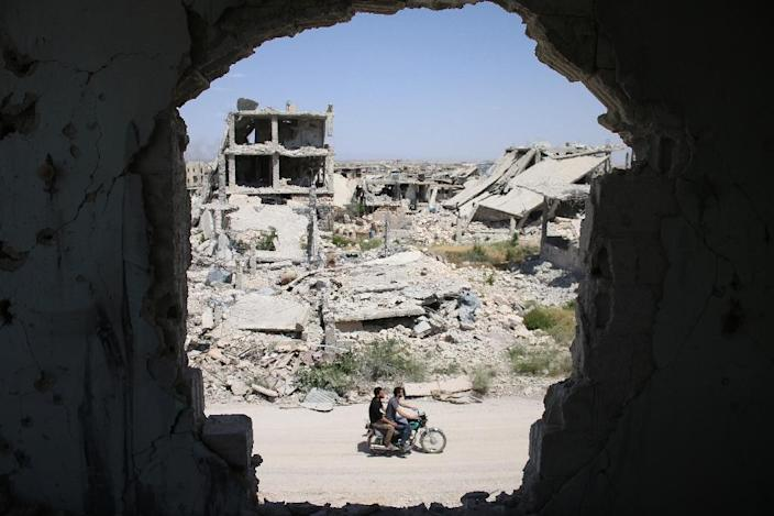 Syria's conflict has killed more than 320,000 people and displaced millions (AFP Photo/Mohamad ABAZEED)