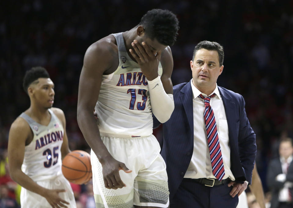 Deandre Ayton (13) and Sean Miller have had a tough couple weeks, but Arizona has thrived on the court throughout the season. (AP)