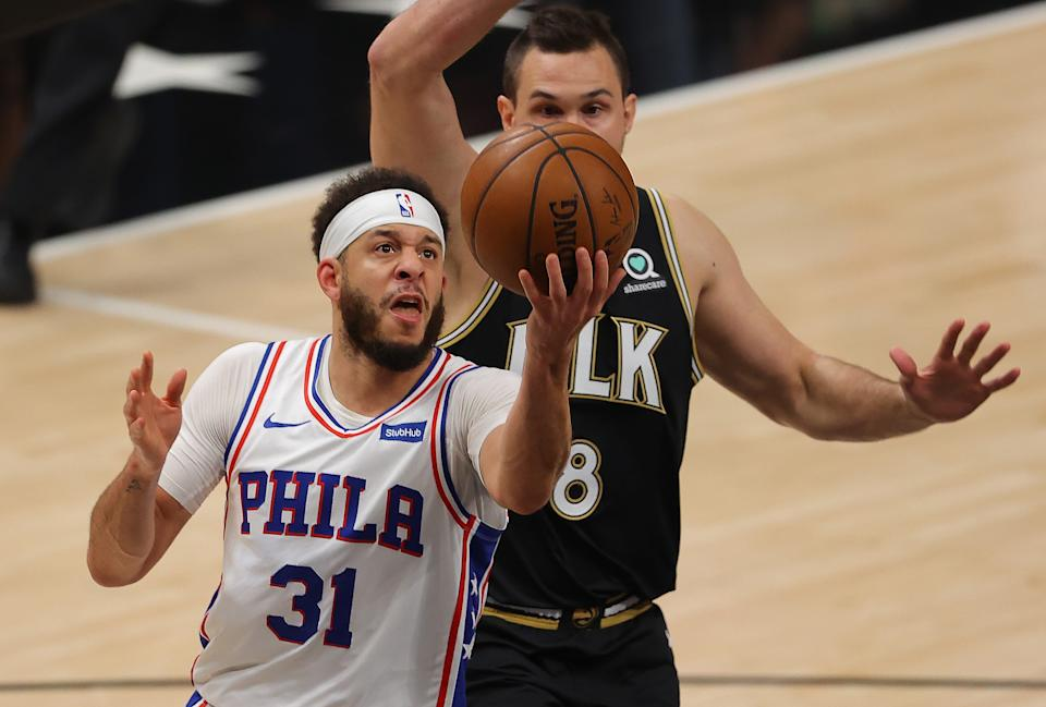 ATLANTA, GEORGIA - JUNE 18:  Seth Curry #31 of the Philadelphia 76ers drives against Danilo Gallinari #8 of the Atlanta Hawks during the first half of game 6 of the Eastern Conference Semifinals at State Farm Arena on June 18, 2021 in Atlanta, Georgia.  NOTE TO USER: User expressly acknowledges and agrees that, by downloading and or using this photograph, User is consenting to the terms and conditions of the Getty Images License Agreement. (Photo by Kevin C. Cox/Getty Images)