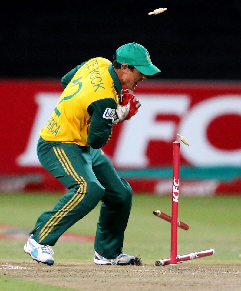 DURBAN, SOUTH AFRICA - MARCH 12:  Quinton de Kock of South Africa dismisses George Bailey of Australia during the 2nd T20 International match between South Africa and Australia at Sahara Stadium Kingsmead on March 12, 2014 in Durban, South Africa. (Photo by Anesh Debiky/Gallo Images/Getty Images)