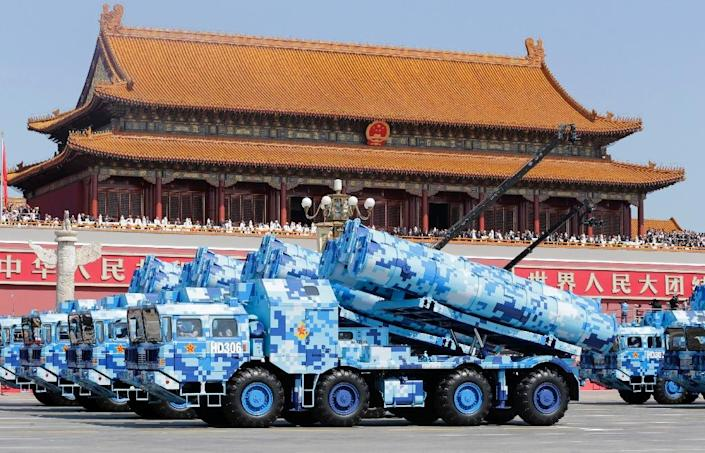 Military vehicles carrying shore-to-ship missiles drive past the Tiananmen Gate during a military parade in Beijing on September 3, 2015 to mark the 70th anniversary of victory over Japan and the end of World War II (AFP Photo/Jason Lee)