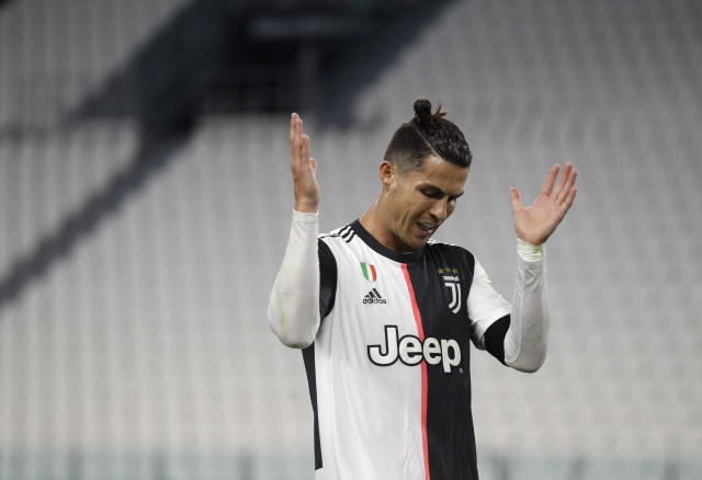 Juventus' Cristiano Ronaldo reacts during an Italian Cup second leg soccer match between Juventus and AC Milan at the Allianz stadium, in Turin, Italy, Friday, June 12, 2020. The match was being played without spectators because of the coronavirus lockdown. (AP Photo/Luca Bruno)
