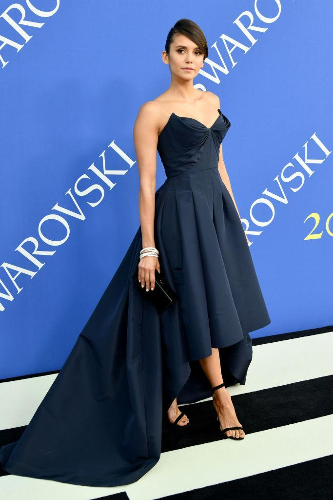 <p>Nina Dobrev wears a navy strapless Zac Posen gown to the 2018 CFDA Fashion Awards on June 4, 2018, in New York City. (Photo: Jared Siskin/Patrick McMullan via Getty Images) </p>