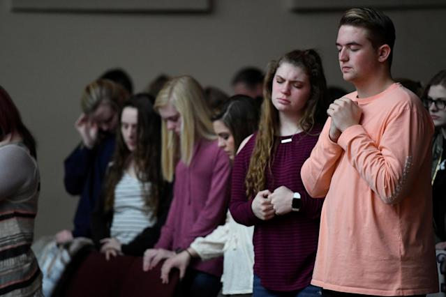 <p>Students attend a prayer vigil for students killed and injured after a 15-year-old boy opened fire with a handgun at Marshall County High School, at Life in Christ Church in Marion, Kentucky, Jan. 23, 2018. (Photo: Harrison McClary/Reuters) </p>