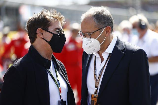 Stefano Domenicali and Tom Cruise chat