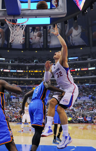 Los Angeles Clippers forward Blake Griffin, right, is hit in the groin by Oklahoma City Thunder forward Serge Ibaka, of Congo, as he puts up a shot in the first half of Game 4 of the Western Conference semifinal NBA basketball playoff series, Sunday, May 11, 2014, in Los Angeles. (AP Photo/Mark J. Terrill)