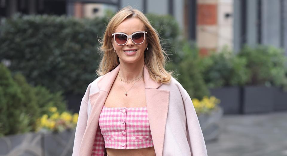 Amanda Holden has recalled the time she accidentally exposed her cleavage during a family lunch at Piers Morgan's LA home. (Getty Images)