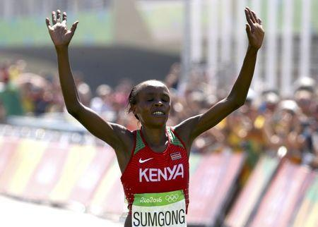 2016 Rio Olympics - Athletics - Final - Women's Marathon -Sambodromo - Rio de Janeiro, Brazil - 14/08/2016. Jemima Sumgong (KEN) of Kenya crosses the finish line to win the race REUTERS/David Gray