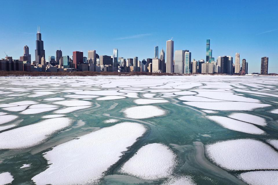 Police pleaded with people to stay off the unpredictable ice which formed along the shoreline of Lake Michigan near downtown Chicago last month (Getty Images)