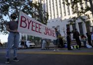 Protesters gather outside the Hall of Justice to protest Los Angeles District Attorney Jackie Lacey in downtown Los Angeles, Wednesday, Nov. 4, 2020. Former San Francisco District Attorney George Gascon led two-term incumbent Lacey with 54% of more than 2.7 million votes counted by Wednesday. (AP Photo/Damian Dovarganes)