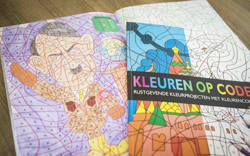 A photo shows a colouring book with an image of Adolf Hitler bought at the Dutch store Kruidvat - ALEXANDER SCHIPPERS