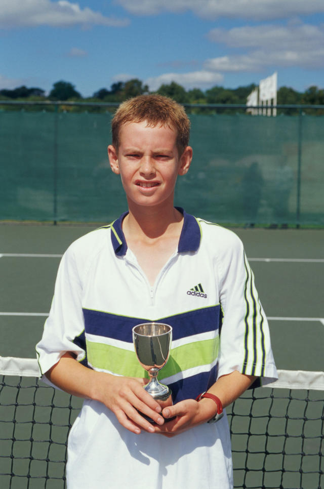 <p>Andy Murray celebrates after winning the Under 14s event during the National Junior Championships. (Getty Images) </p>
