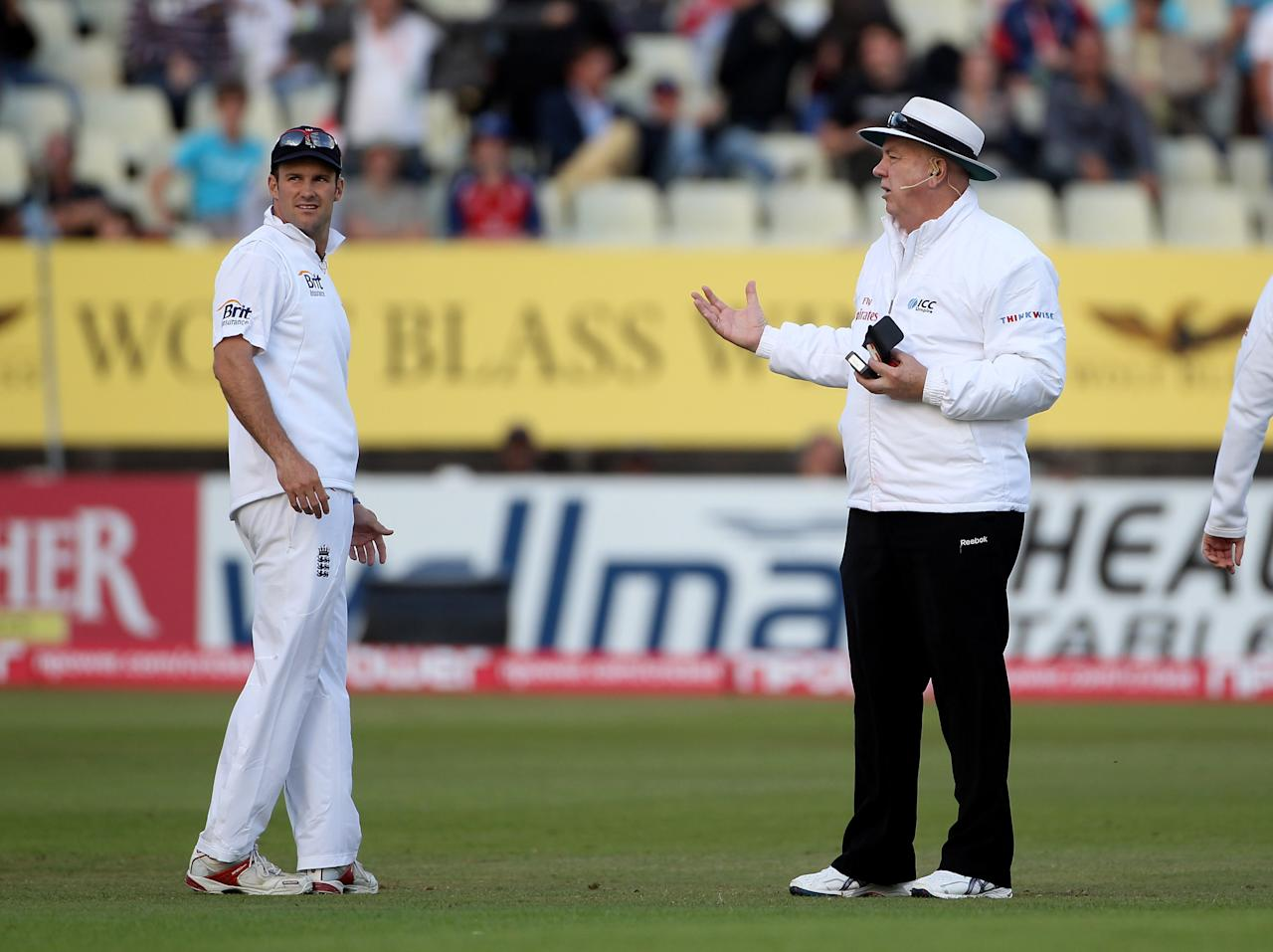 BIRMINGHAM, ENGLAND - AUGUST 07:  Andrew Strauss of England has a chat with umpire Steve Davis after play was stopped by bad light during day two of the 2nd npower Test Match between England and Pakistan at Edgbaston on August 7, 2010 in Birmingham, England.  (Photo by Tom Shaw/Getty Images)