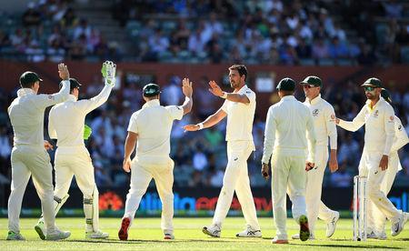 Australia's Mitchell Starc (C) celebrates after taking a wicket during day one of the first test match between Australia and India at the Adelaide Oval in Adelaide, Australia, December 6, 2018. AAP/Dave Hunt/via REUTERS.