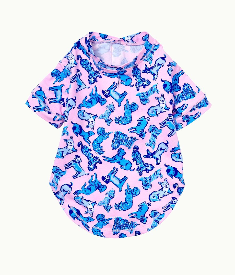"""<p><strong>Lilly Pulitzer</strong></p><p>lillypulitzer.com</p><p><strong>$38.00</strong></p><p><a href=""""https://go.redirectingat.com?id=74968X1596630&url=https%3A%2F%2Fwww.lillypulitzer.com%2Flilly-dog-pj-shirt%2F005240.html%3Fdwvar_005240_color%3D4221OE&sref=https%3A%2F%2Fwww.marieclaire.com%2Fhome%2Fg24851290%2Fbest-dog-gifts%2F"""" rel=""""nofollow noopener"""" target=""""_blank"""" data-ylk=""""slk:SHOP IT"""" class=""""link rapid-noclick-resp"""">SHOP IT</a></p><p>Yes, Lilly Pulitzer makes dog pajamas now—and if you're so inclined, you can get <a href=""""https://www.lillypulitzer.com/pj-knit-ruffle-tank-top/000074.html?cgid=pajamas&dwvar_000074_color=4221OE#start=1"""" rel=""""nofollow noopener"""" target=""""_blank"""" data-ylk=""""slk:matching pajamas"""" class=""""link rapid-noclick-resp"""">matching pajamas</a> for your whole family. </p>"""