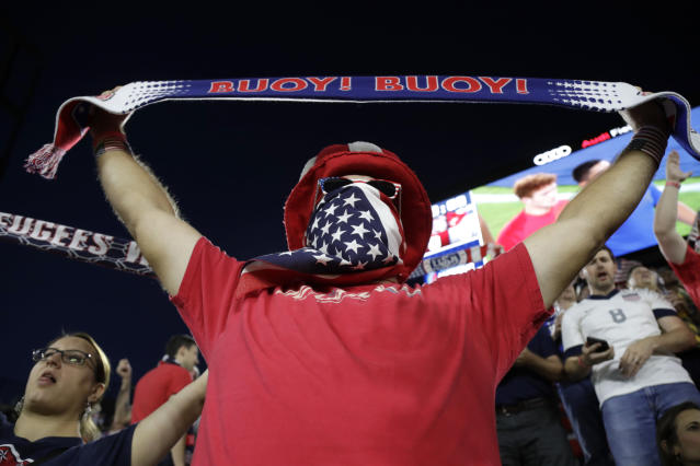 A U.S. supporter cheers prior to a CONCACAF Nations League soccer match between the United States and Cuba on Friday, Oct. 11, 2019, in Washington. (AP Photo/Julio Cortez)