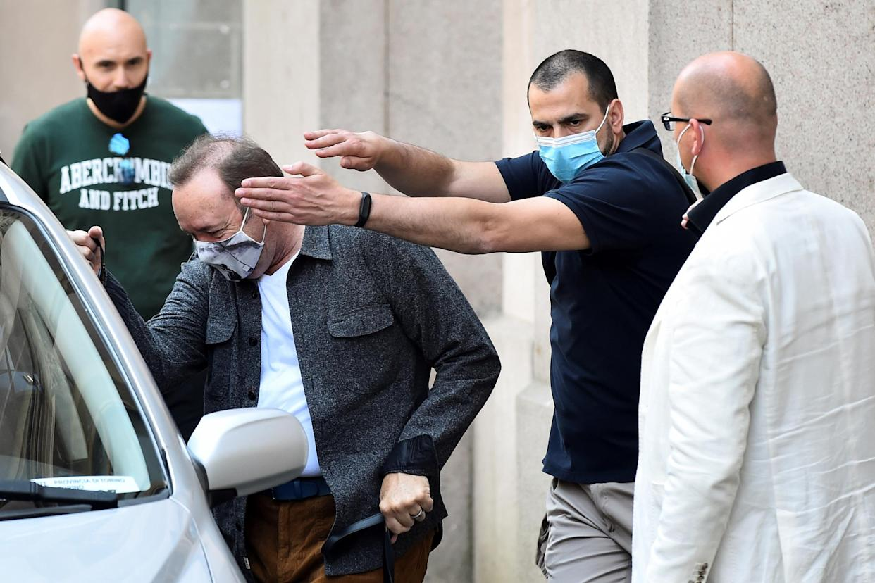 Actor Kevin Spacey leaves the Mole Antonelliana building as he visits the city, where he is expected to return for a cameo appearance in a low budget Italian film, after largely disappearing from public view, in Turin, Italy, June 1, 2021. REUTERS/Massimo Pinca