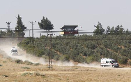 Ambulances leave from the Dag military post, which was attacked by Islamic State militants on Thursday, on the Turkish-Syrian border near Kilis, Turkey,