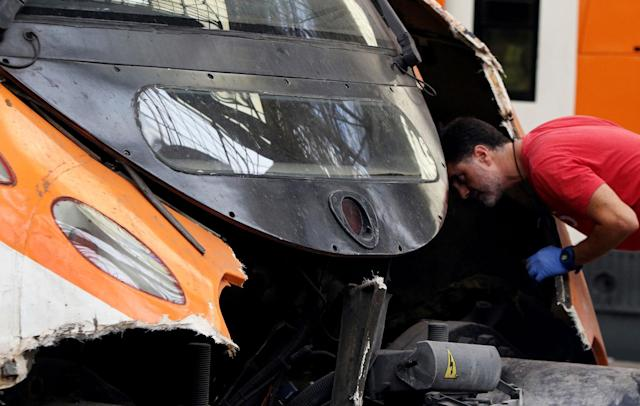 <p>A worker looks at the front of a commuter train after it ran into the buffers on the platform of a train station in Barcelona, Spain, Friday July 28, 2017. (Photo: Adrian Quiroga/AP) </p>