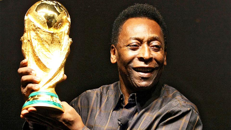Pele (pictured) holding up the World Cup trophy.