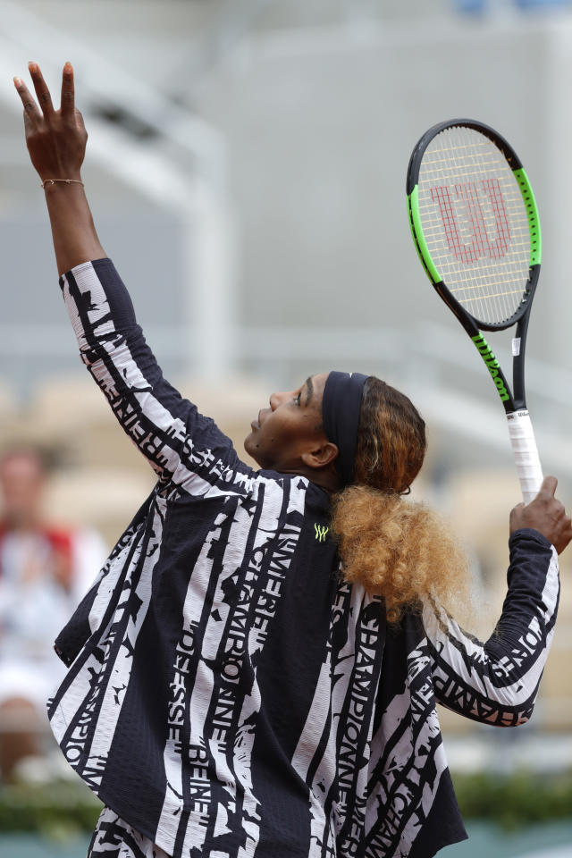 "Serena Williams of the U.S. wears a jacket with French text reading ""Mother, Goddess, Champion, Queen"", as she warms up for her second round match of the French Open tennis tournament against Japan's Kurumi Nara at the Roland Garros stadium in Paris, Thursday, May 30, 2019. (AP Photo/Pavel Golovkin)"
