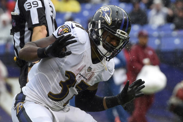 Rain drips off of Baltimore Ravens running back Javorius Allen's (37) helmet as he celebrates his touchdown during the second half of an NFL football game against the Buffalo Bills, Sunday, Sept. 9, 2018, in Baltimore. (AP Photo/Gail Burton)