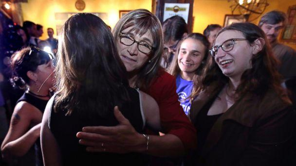 Vermont Democratic gubernatorial candidate Christine Hallquist, center, a transgender woman and former electric company executive, embraces supporters after claiming victory during her election night party in Burlington, Vt., Tuesday, Aug. 14, 2018. (AP)