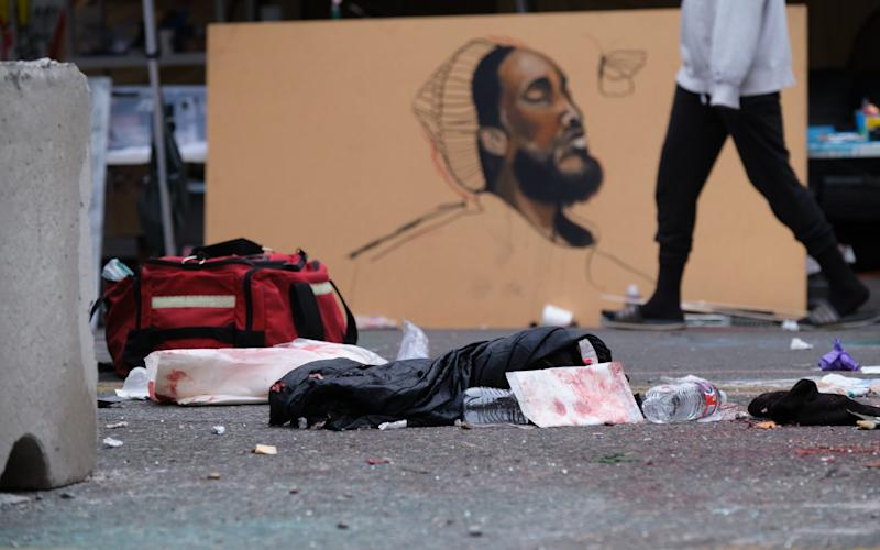 Used medical supplies are left behind at the site of a fatal shoooting, in which at least one person was killed after a car rammed a concrete barricade at the Capitol Hill Occupied Protest - STEPHEN BRASHEAR/EPA-EFE/Shutterstock/Shutterstock