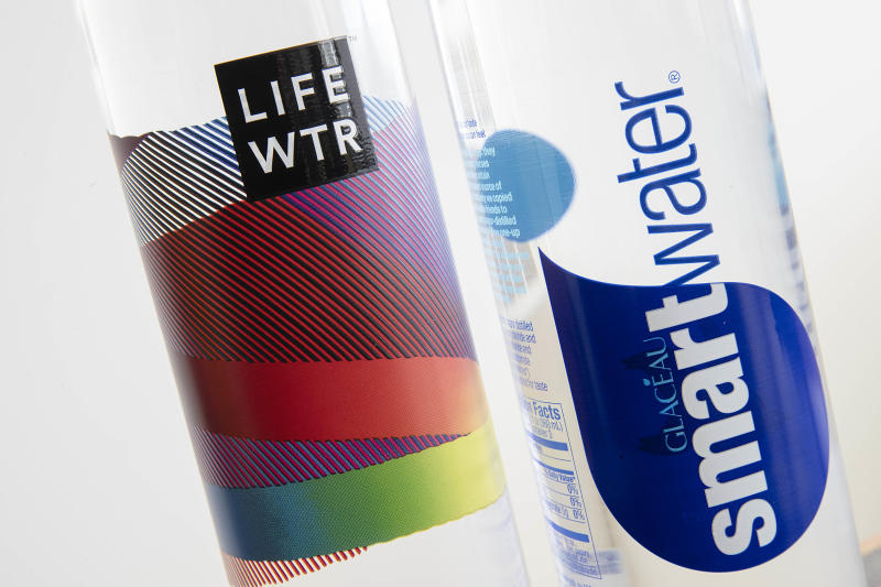 "In this Thursday, March 16, 2017, photo, bottles of Lifewtr and Smartwater are displayed in Philadelphia. As bottled water surges in popularity, Coke, Pepsi and other companies are using celebrity endorsements, stylish packaging and fancy filtration processes like ""reverse osmosis"" to sell people on expanding variations of what comes out of the tap. They're also adding flourishes like bubbles, flavors or sweeteners that can blur the lines between what is water and what is soda. (AP Photo/Matt Rourke)"