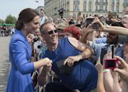 <p><b><b><b>The crowd went wild for Kate as she and William visited the Brandenburg Gate.<br><i>[Photo: PA]</i> </b></b></b></p>