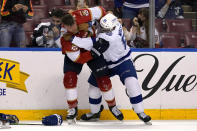 Florida Panthers defenseman Kevin Connauton, left, and Tampa Bay Lightning defenseman Daniel Walcott (85) fight during the second period of an NHL hockey game, Monday, May 10, 2021, in Sunrise, Fla. (AP Photo/Lynne Sladky)