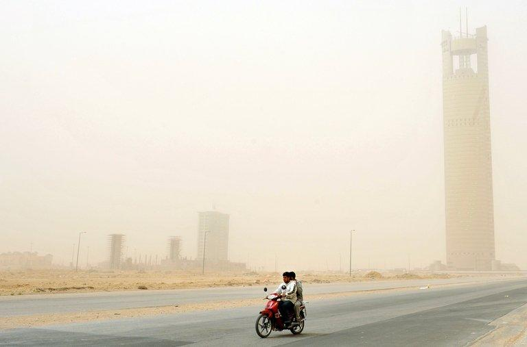 Photo illustration shows a motorbike passing through a over the Saudi capital of Riyadh. Islam also offers a repertoire of tales of mass destruction -- by sandstorm, invasion or fire