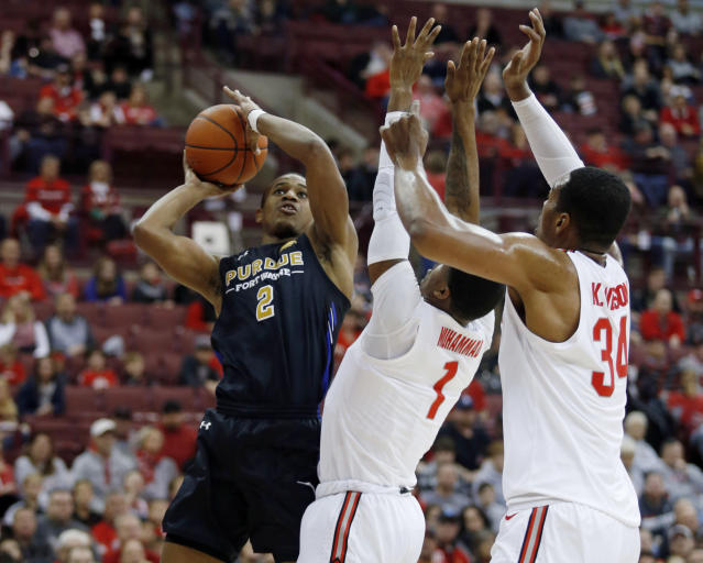Purdue Fort Wayne guard Brian Patrick, left, goes up for a shot in front of Ohio State guard Luther Muhammad, center, and forward Kaleb Wesson during the first half of an NCAA college basketball game in Columbus, Ohio, Friday, Nov. 22, 2019. (AP Photo/Paul Vernon)