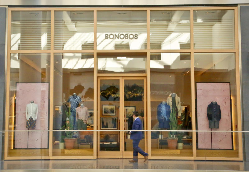 In this Monday, March 20, 2017, photo, a man walks by the Bonobos Guideshop in New York's Financial District. More shoppers are looking to social media or curated selections for fashion inspiration. That adds to the woes of mall-based stores, as people are already buying fewer clothes, spending online or at discounters when they do, and demanding more personal and convenient ways to buy. (AP Photo/Bebeto Matthews)