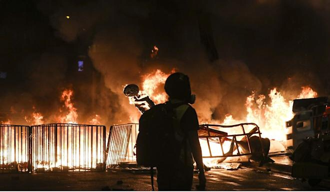 Protesters had set a roadblock in Wan Chai on fire on August 31 last year. Photo: Sam Tsang